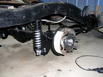 Wheel axle and suspension